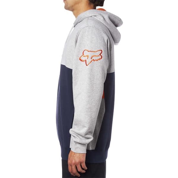 linker Oberarm mit orangenen Fox Logo