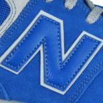 """blaues """"N"""" Logo auf grauen Untergrund"""
